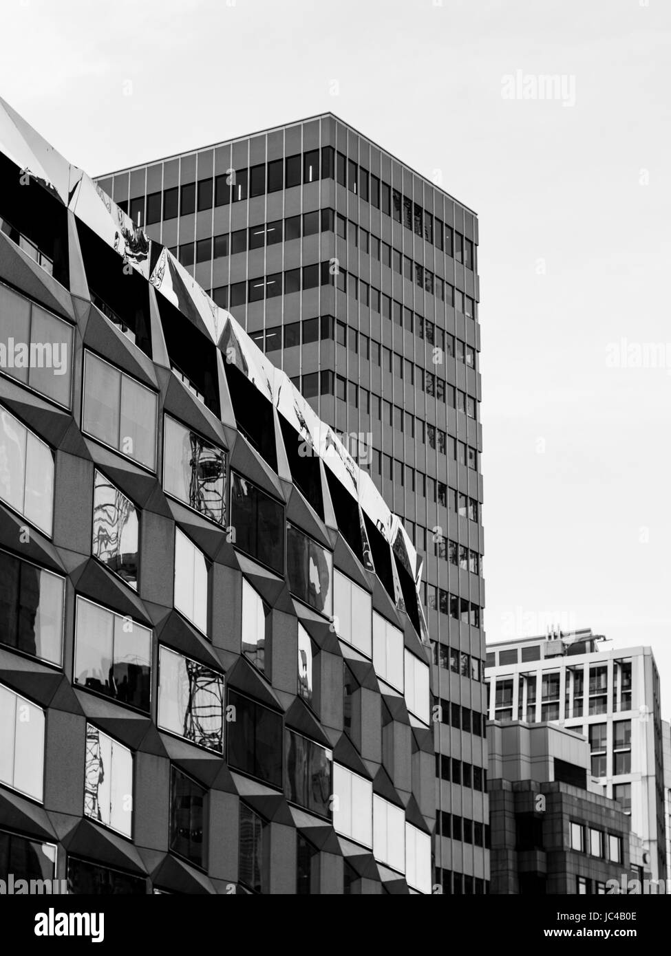 Old and new buildings jostle for space in central London - Stock Image
