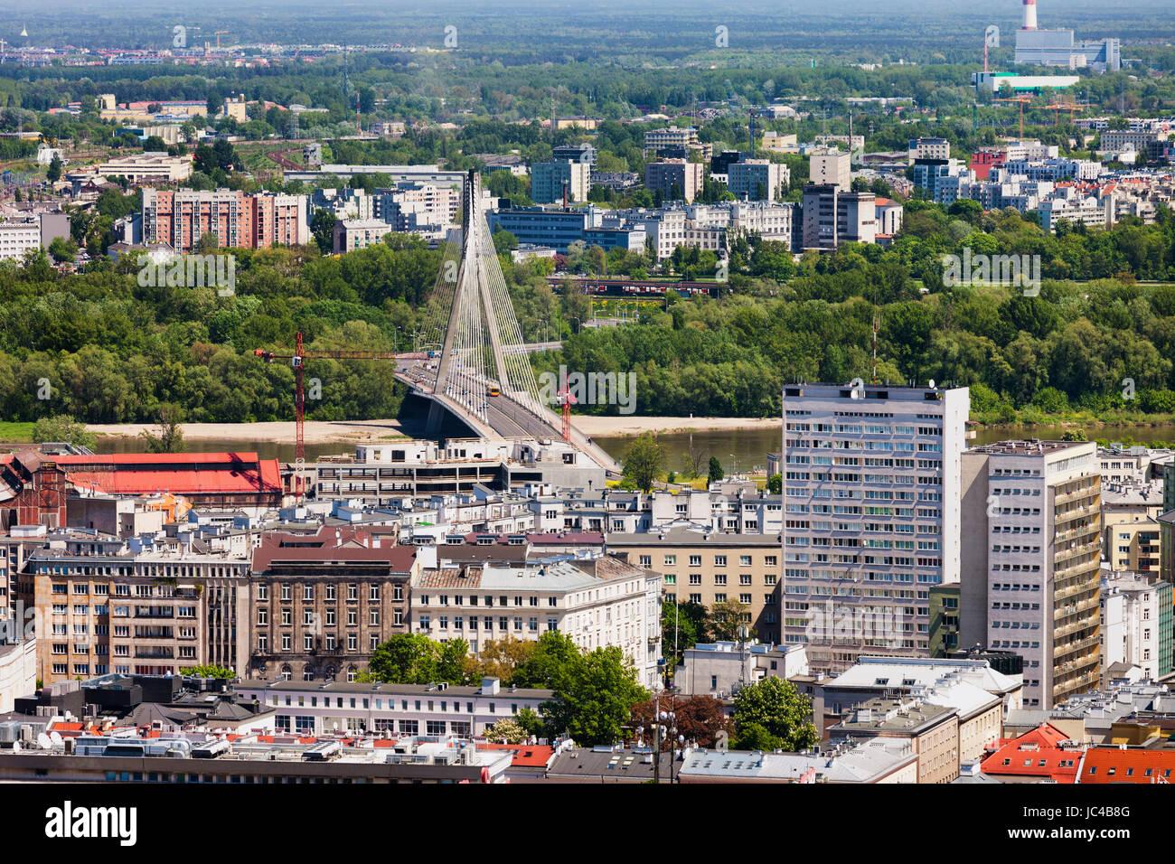 Poland, Warsaw, view over the city from Srodmiescie to Praga district, Vistula River with Swietokrzyski Bridge - Stock Image