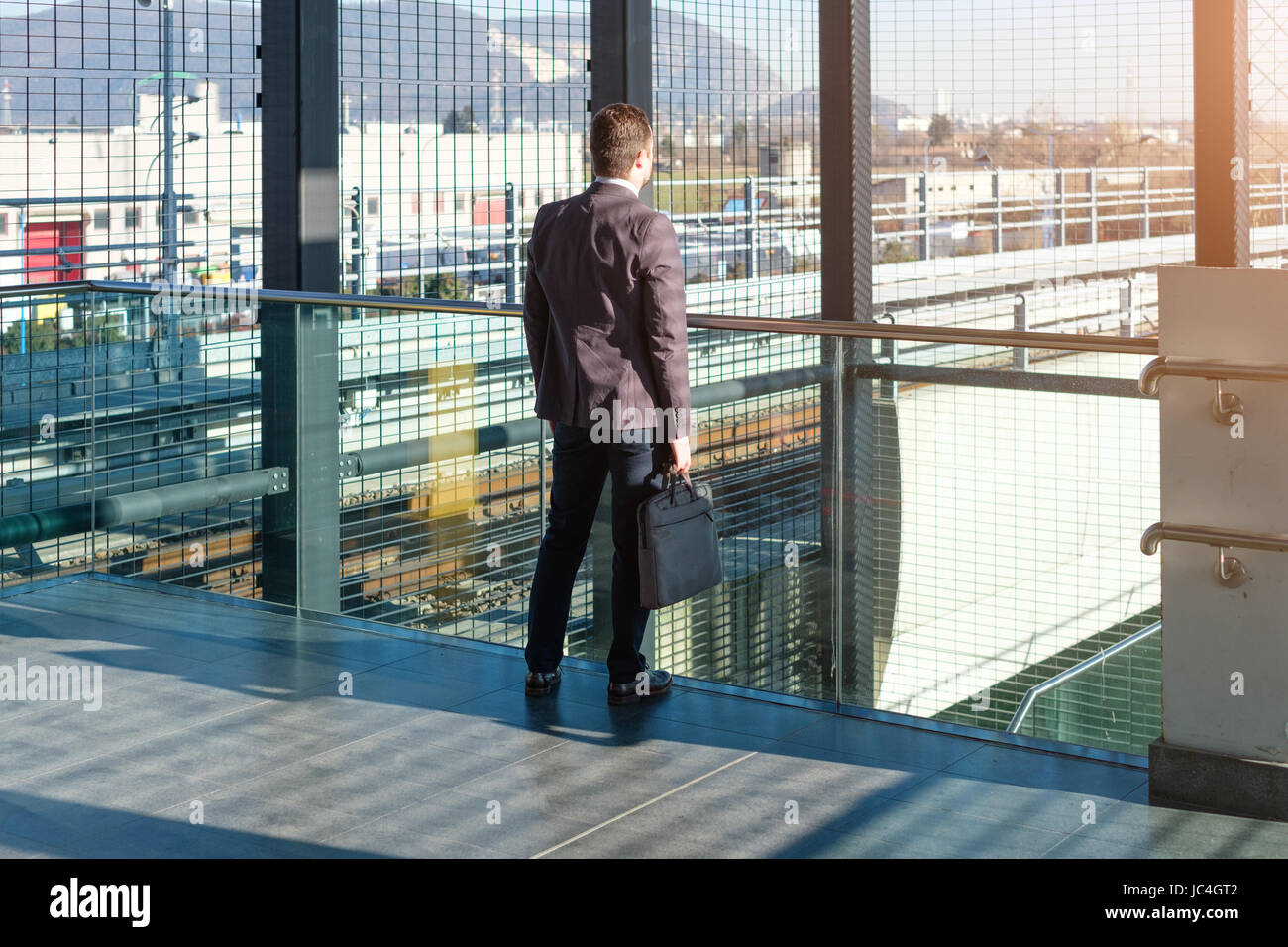 Businessman commuter is traveling and he is sad and tired alone - Stock Image