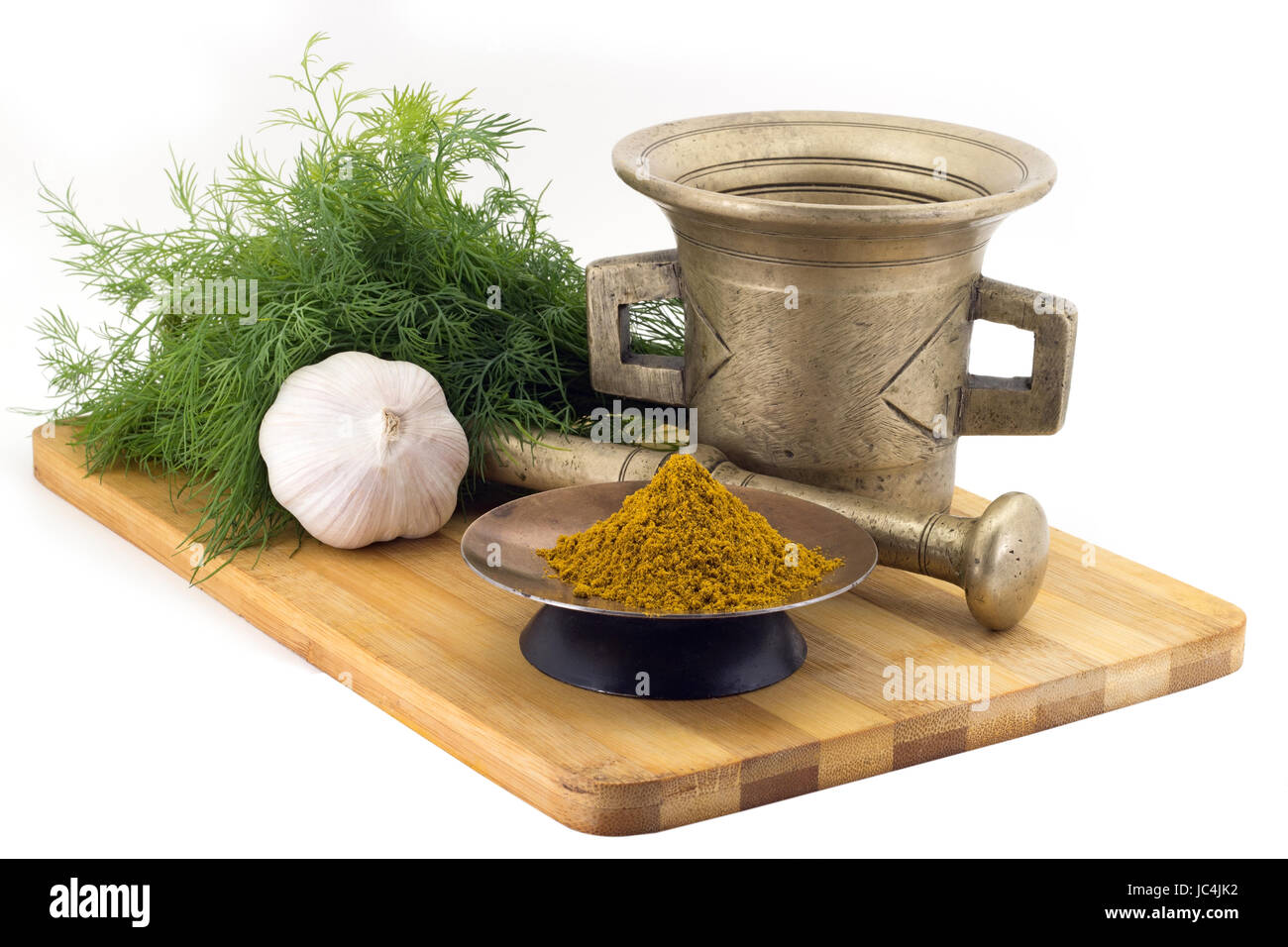 Still Life Spices,Kari spice mix ,marigold staminas in a copper vase on a wooden board on a background of a stern - Stock Image