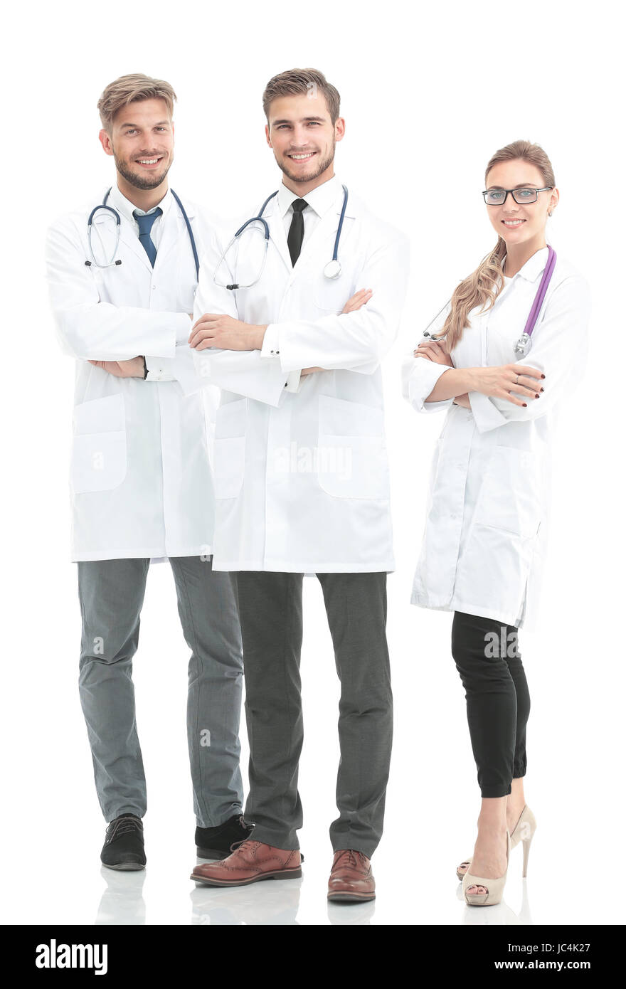 Portrait of group of smiling hospital colleagues standing togeth - Stock Image