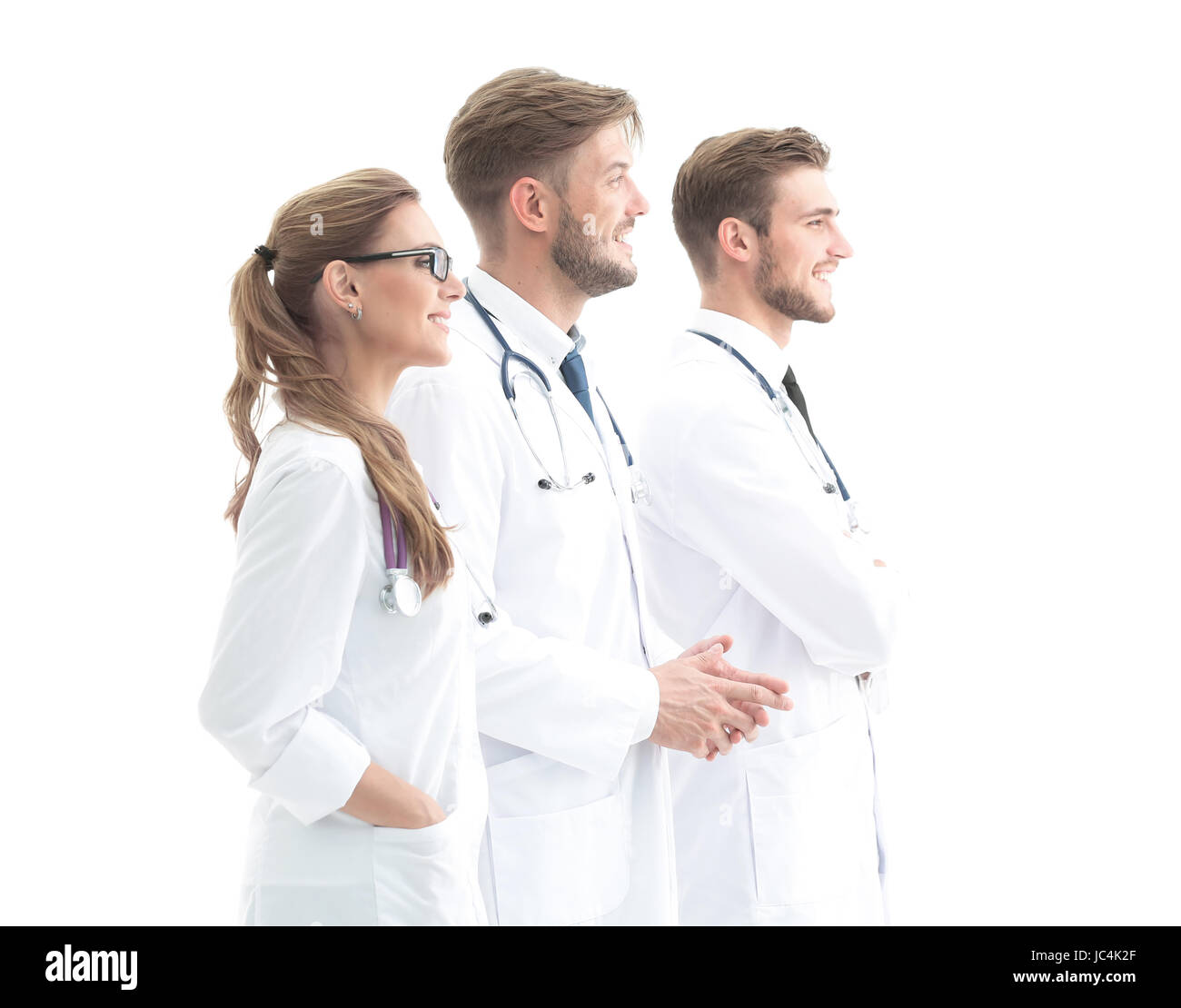 Happy doctors in formalwear looking to the side. - Stock Image
