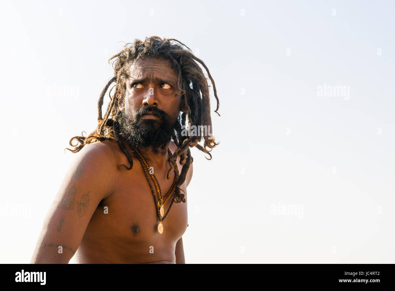 Portrait of a Sadhu, holy man, on a platform at the holy river Ganges at Meer Ghat in the suburb Godowlia Stock Photo