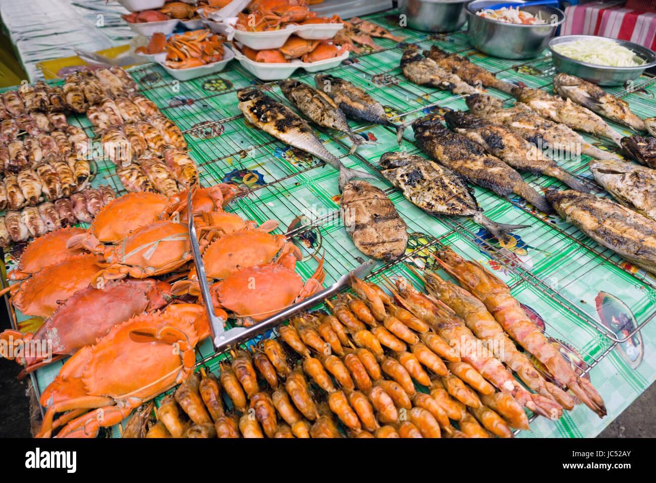 Grilled seafood at Filipino night market in Kota Kinabalu sabah Borneo - Stock Image