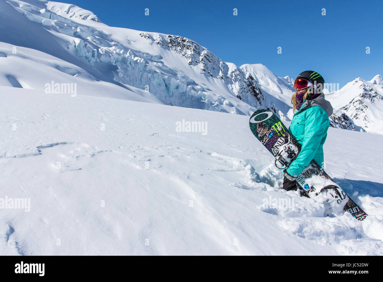 Professional Snowboarder and 2014 Olympic Gold Medalist, Jamie Anderson enjoys the mountains on a sunny bluebird - Stock Image