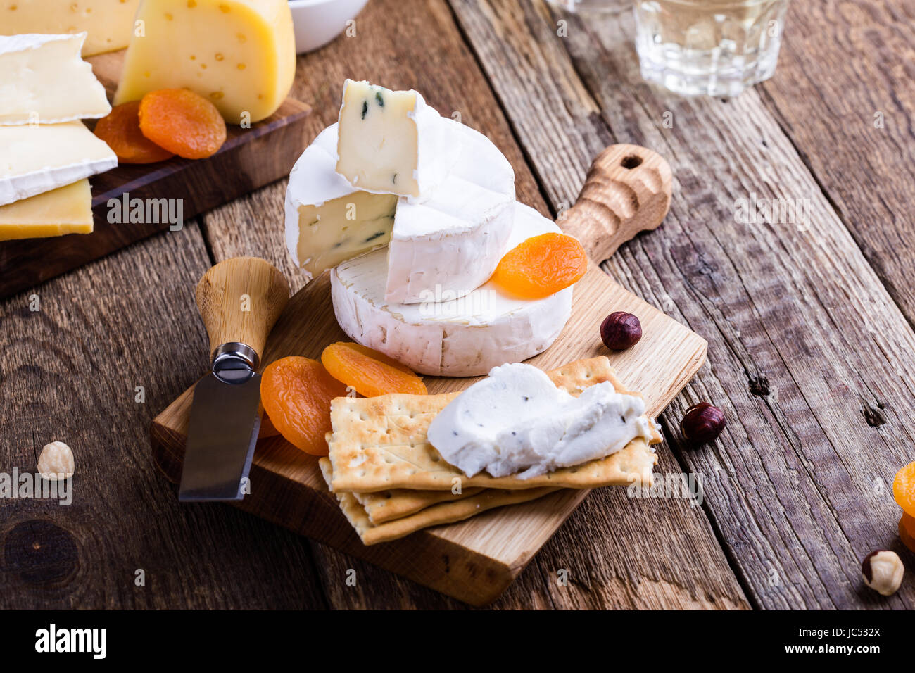 Cheese and wine party  table, perfect holiday appetizer on rustic wooden board Stock Photo