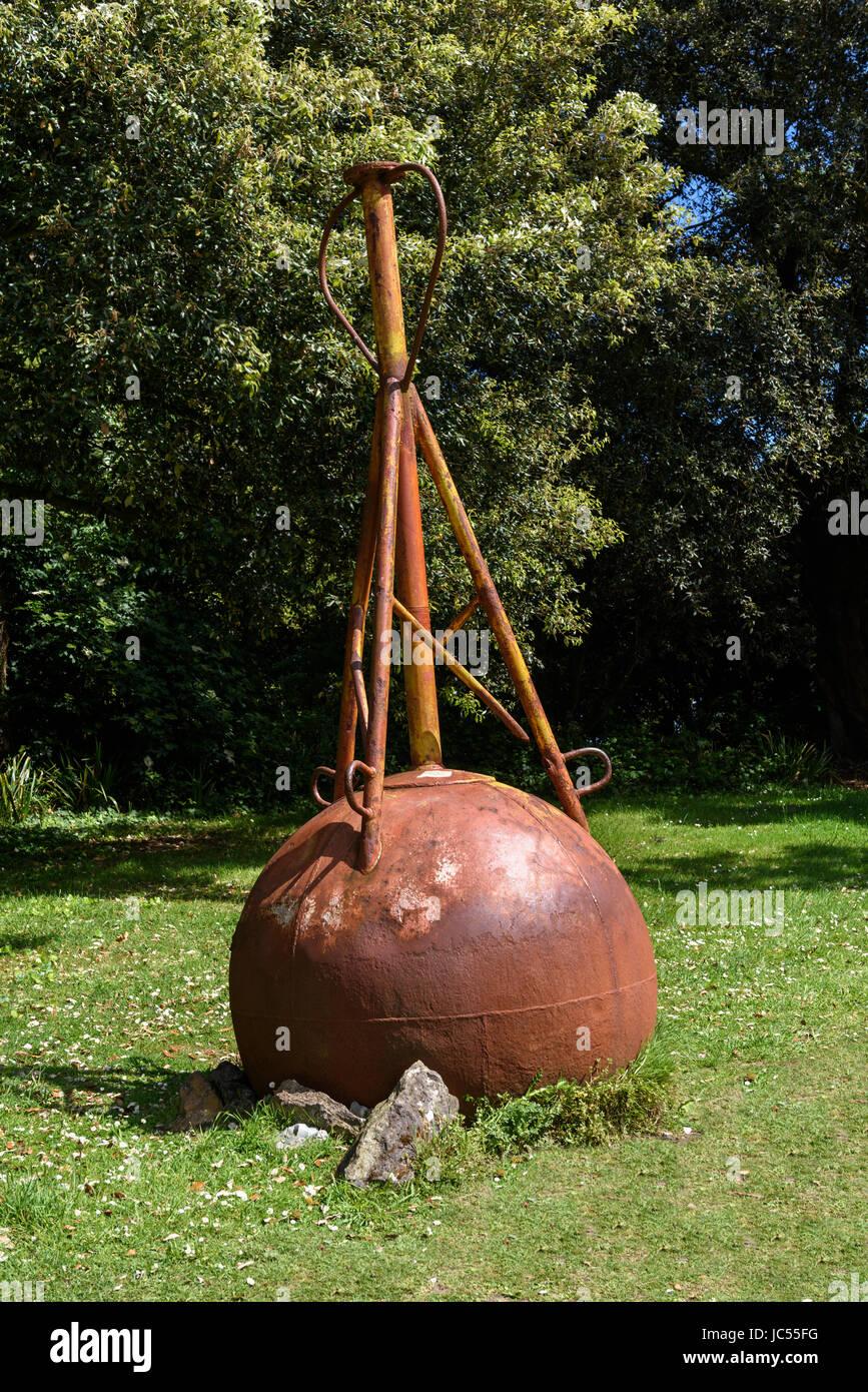 Rusted buoy, Ventnor Botanic Gardens, Isle of Wight, UK - Stock Image