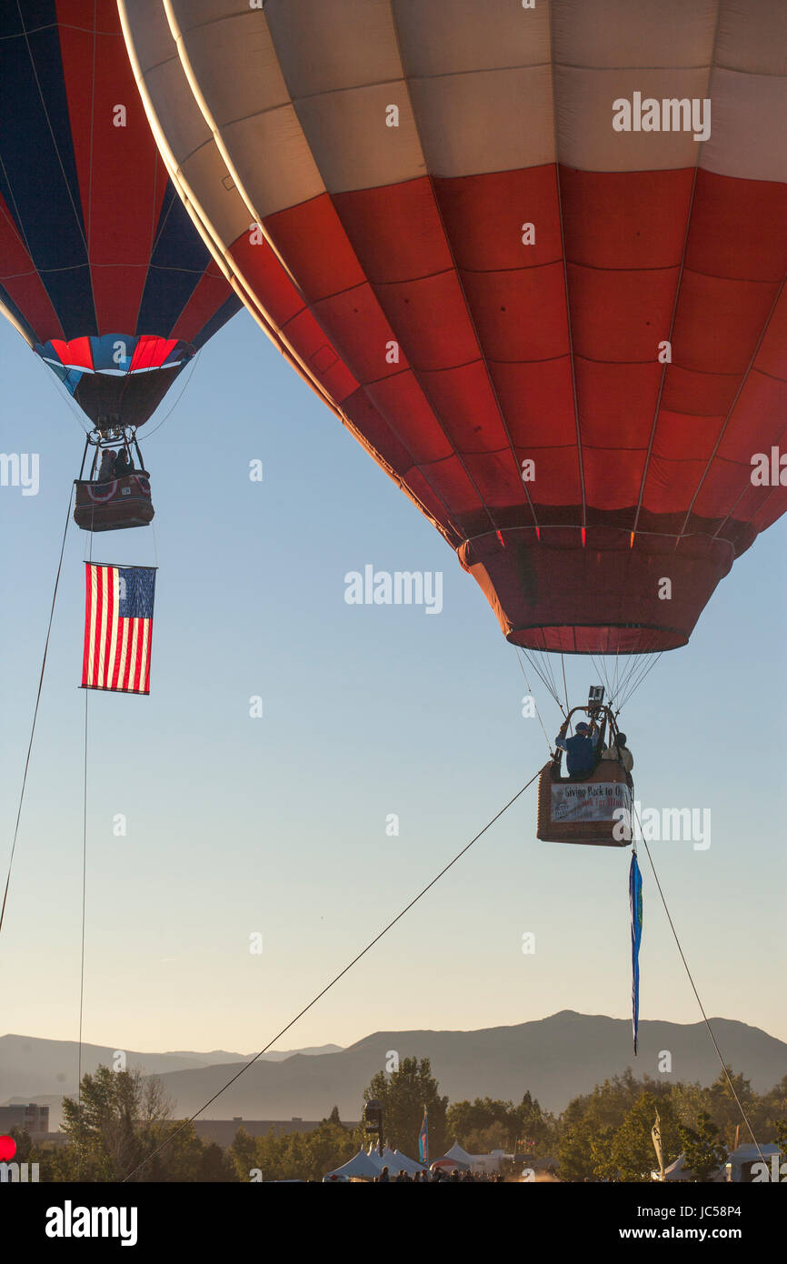 Flag raising during the Reno Balloon Race. - Stock Image