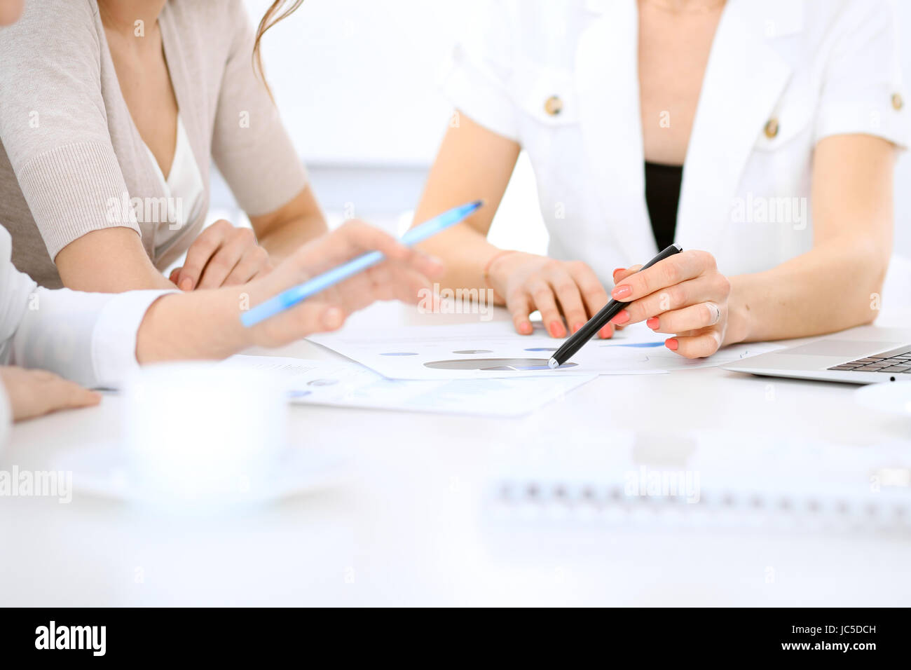 Group of business people, architects or designers at meeting in office - Stock Image