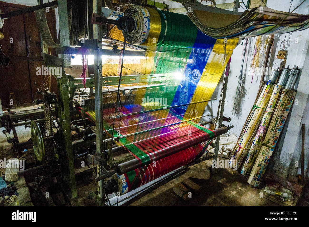 An old fashion handloom for weaving silk material in a factory in the suburb Godowlia - Stock Image
