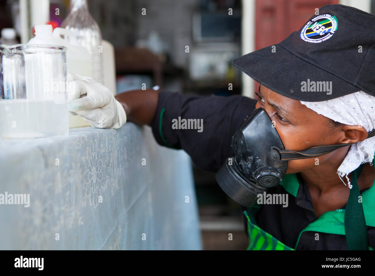 Female small business owner, making cleaning products, Tanzania, Africa Stock Photo