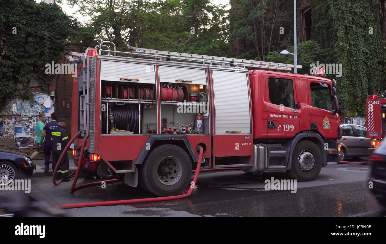 Greek Fire Service tracks during fire. Hellenic Fire Brigade vehicles on the street during a city fire in Thessaloniki, - Stock Image