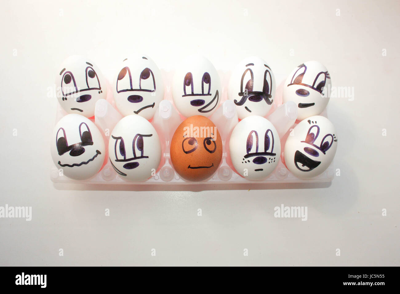 Concept of racial discrimination. White and black. Eggs with painted face. on a white background. Photo for your - Stock Image