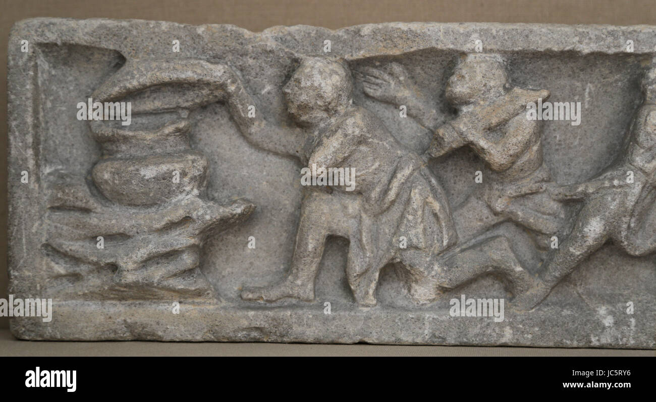 Relief sarcophagus. Reduction by boiling of mustum (newly pressed wine). Roman, 3rd cent. AD. British Museum. London. - Stock Image