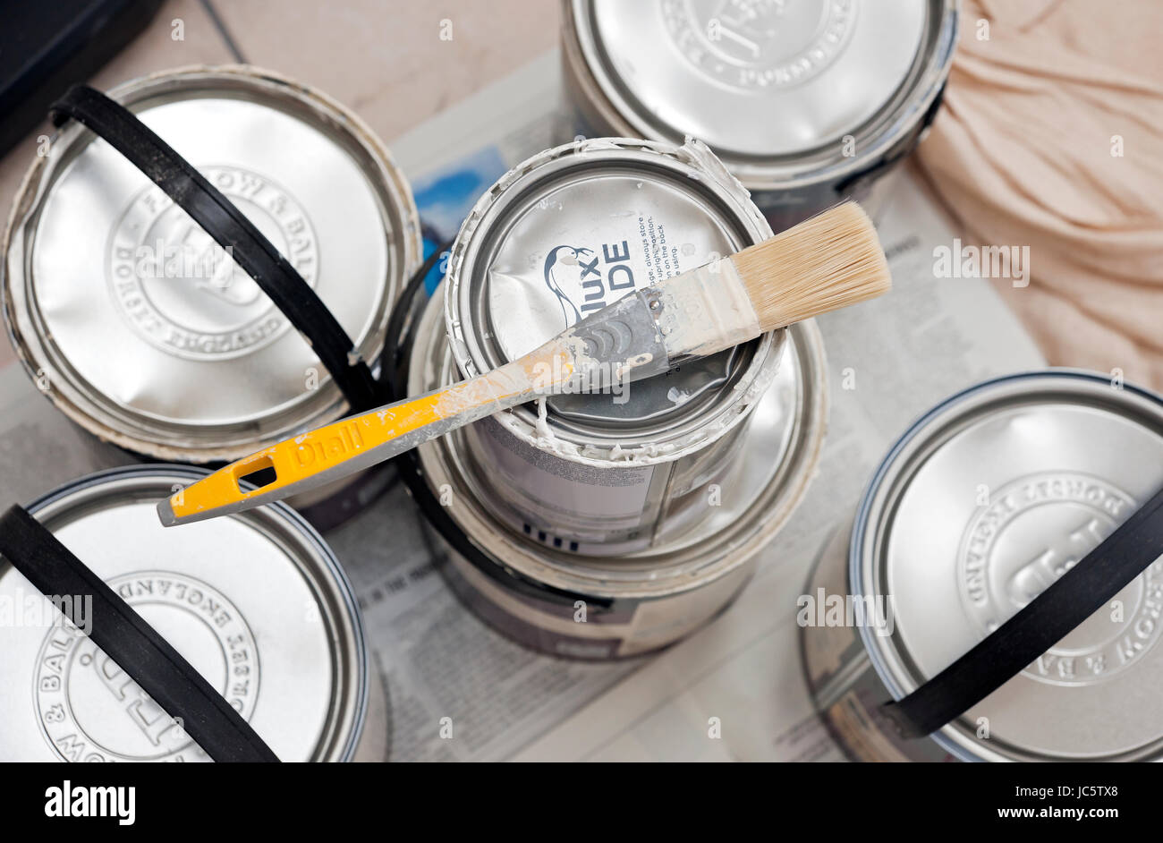 Paint brush and cans of paint Stock Photo