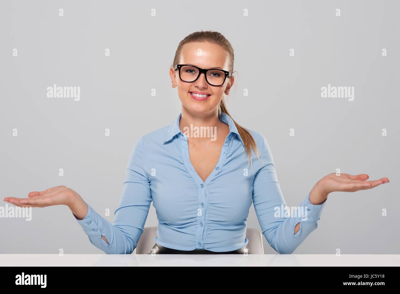 Confident businesswoman welcome gesture Stock Photo