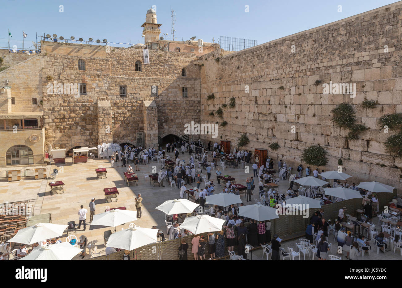 People praying at the Wailing Wall, at the Western Wall Plaza in the Jewish Quarter of the Old City, Jerusalem, - Stock Image