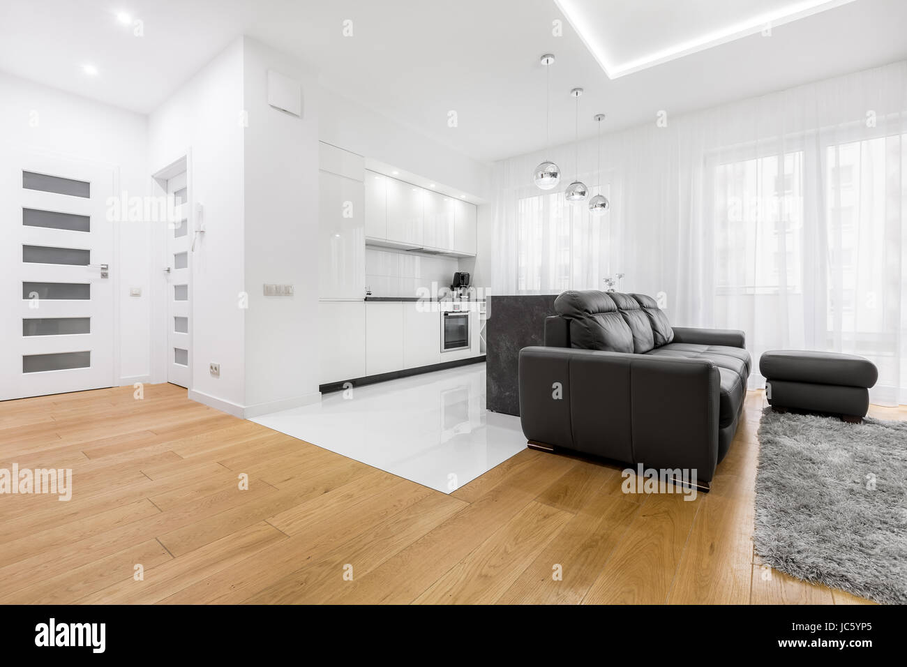 Prime White Living Room With Hardwood Floor And Black Sofa Stock Beatyapartments Chair Design Images Beatyapartmentscom