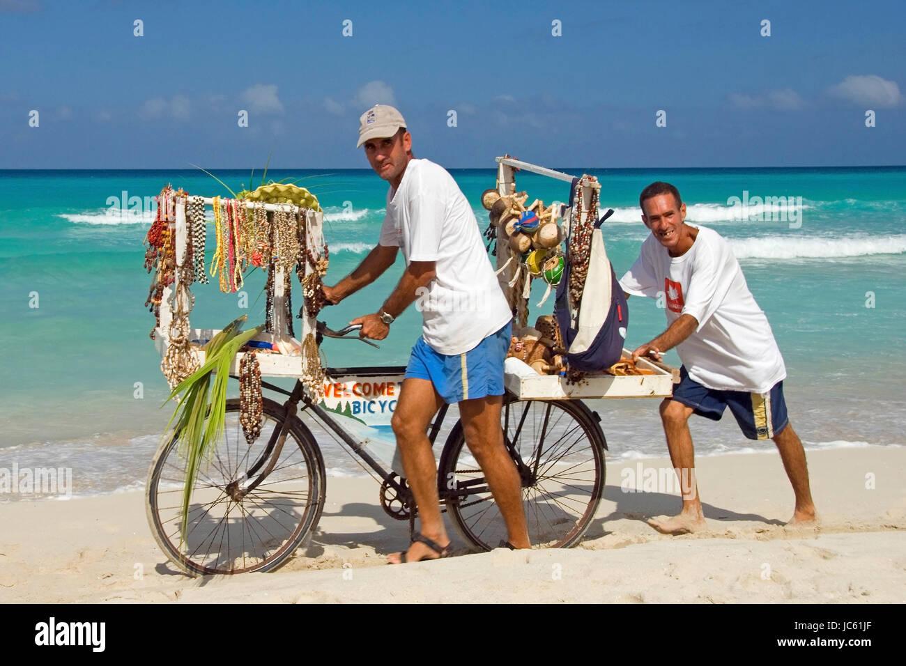 Cuba, the Caribbean, Varadero, beach shop assistant by bicycle, Kuba, Karibik,  Strandverkaeufer mit Fahrrad Stock Photo