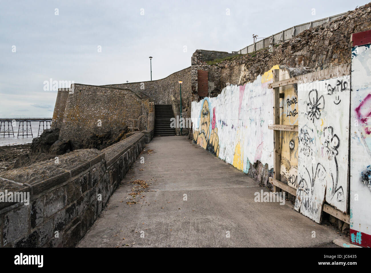 Path on top on coatal wall by the site of the now demolished Royal Pier Hotel, Weston-super-Mare - Stock Image