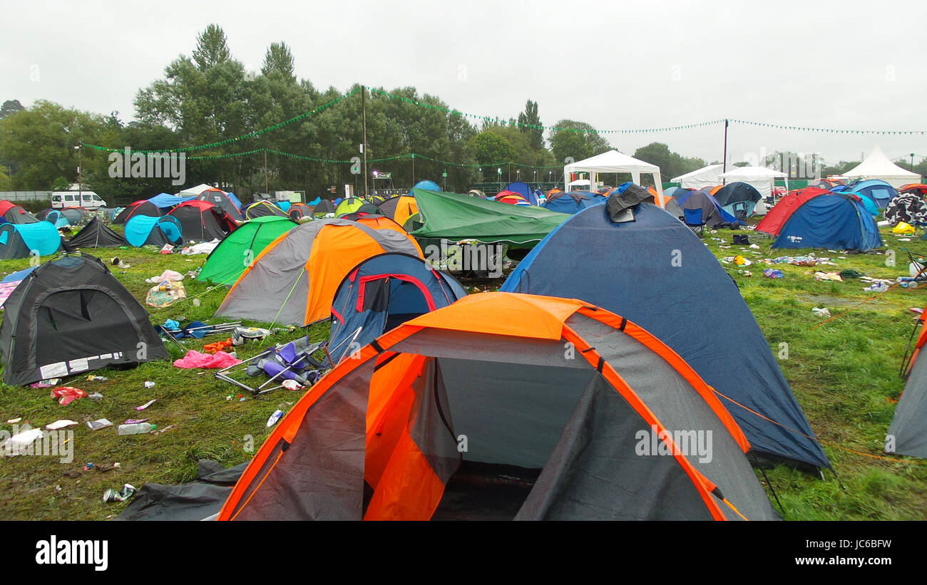The mess that is left behind after the music festival, abandoned tents and rubbish everywhere - Stock Image