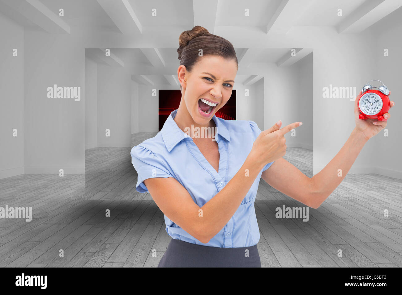 Composite image of businesswoman indicating alarm clock with finger - Stock Image