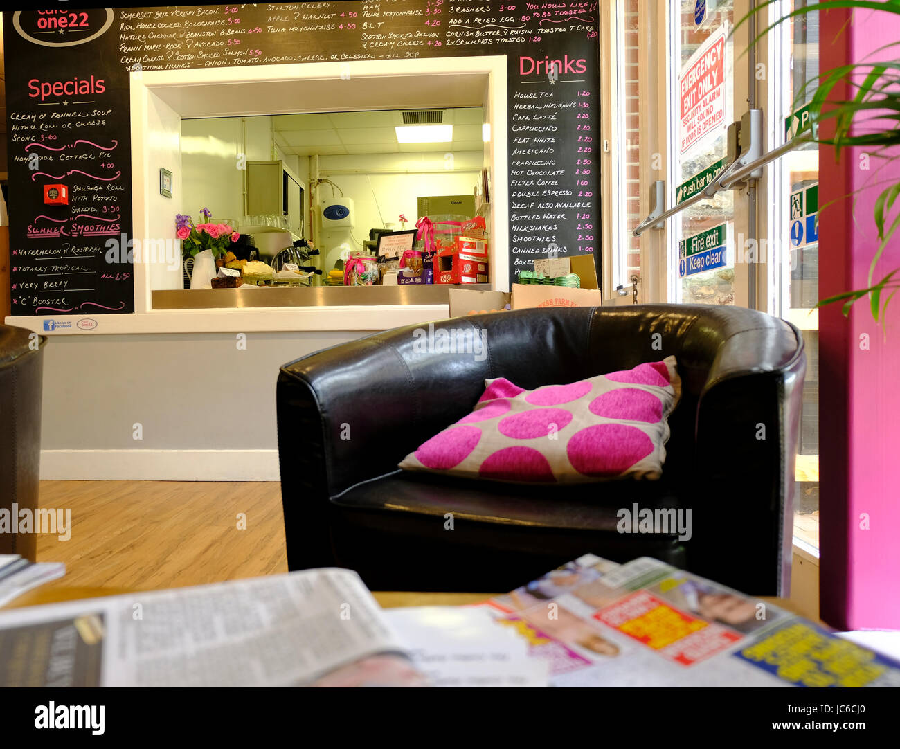 UK Cafe interior with comfy chairs and newspapers - Stock Image