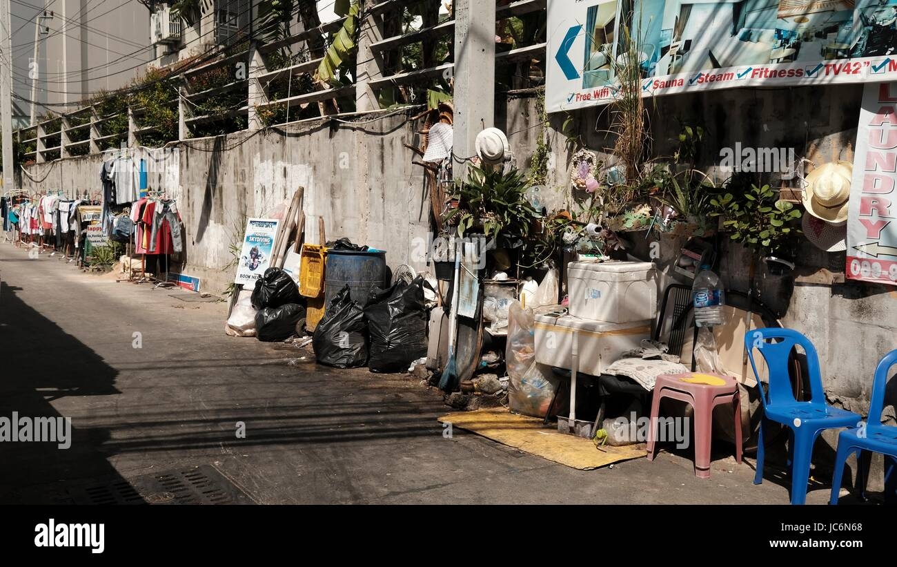 Small Soi Alley  Slum off Soi DianaTrash All Over the Place in Pattaya Thailand Stock Photo