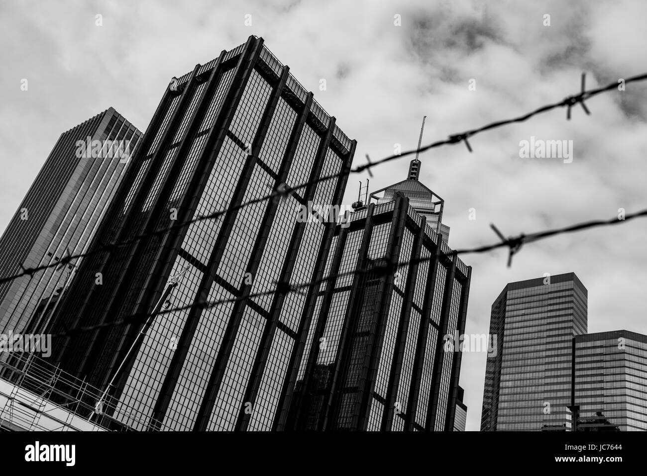 Black and white perspective of a construction site in Hong Kong with other tall buildings in the background and - Stock Image