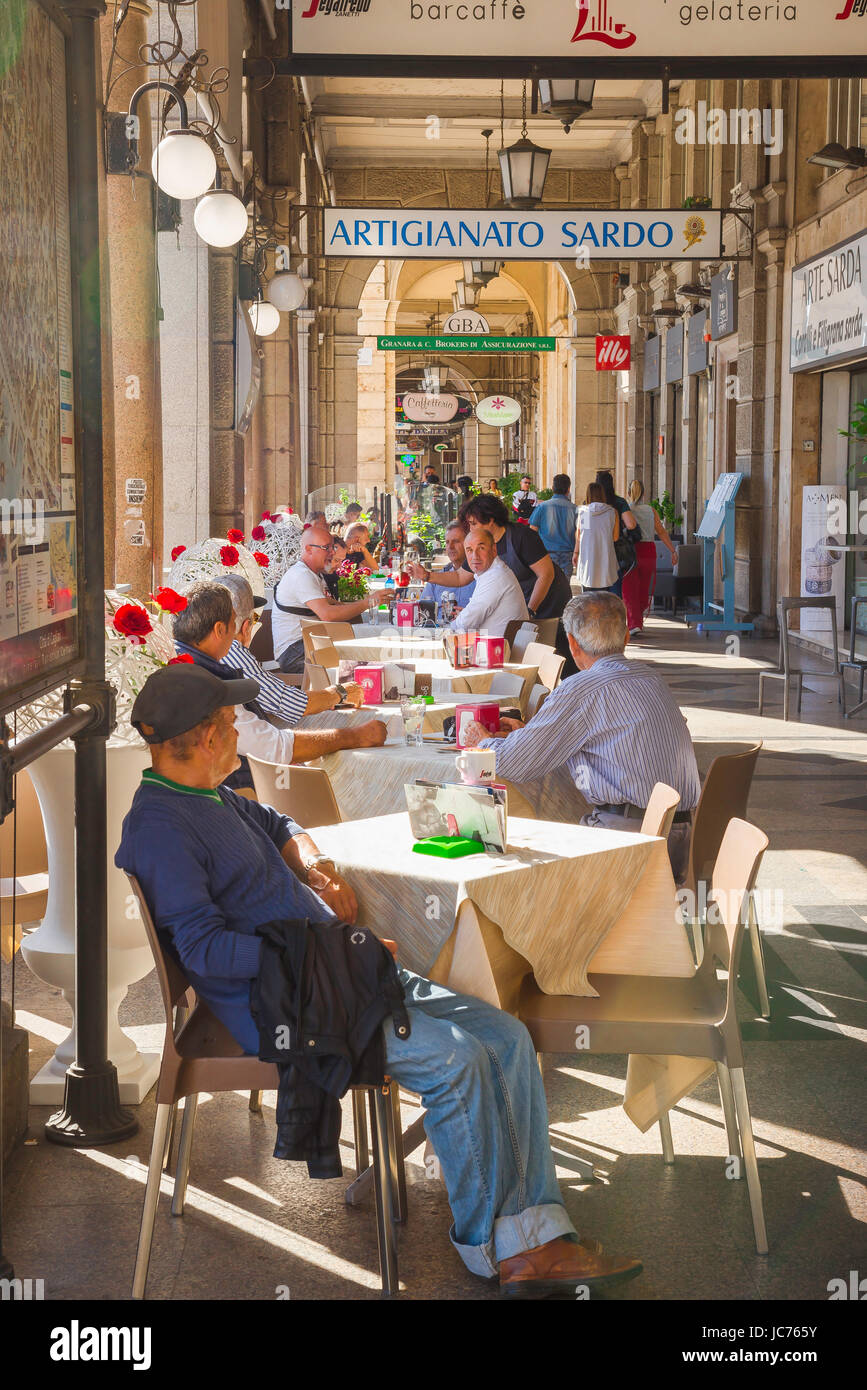 Cagliari arcade, people relax at a cafe terrace inside the arcaded street that runs along the Via Roma in the Marina - Stock Image