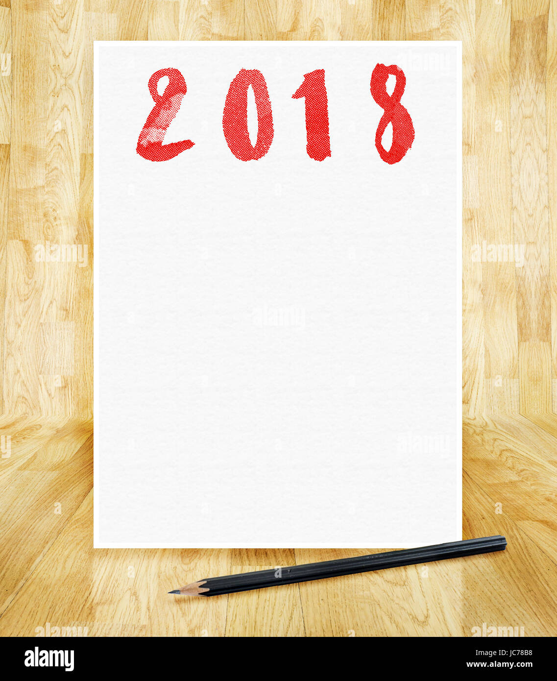 Happy new year 2018 on white paper frame with pencil in hand brush ...