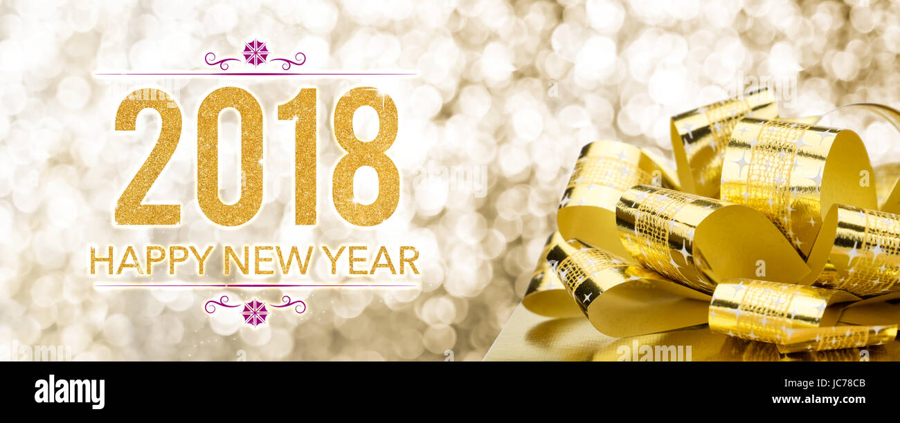happy new year 2018 with golden gift box with big bow at sparkling bokeh blur backgroundholiday greeting card banner