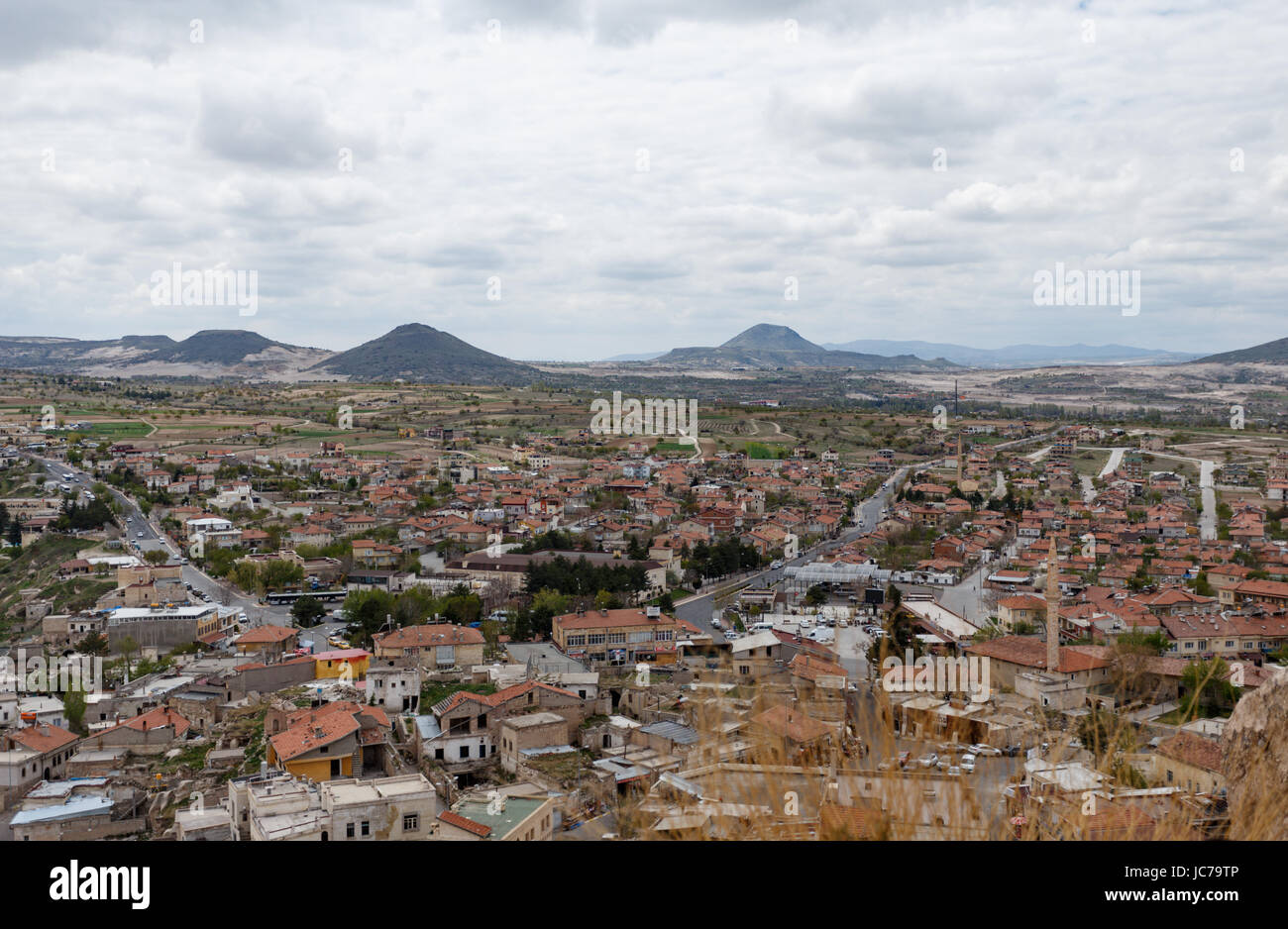 Horiziontal view from Uchhisar castle over touristic villages and rock formations - Stock Image
