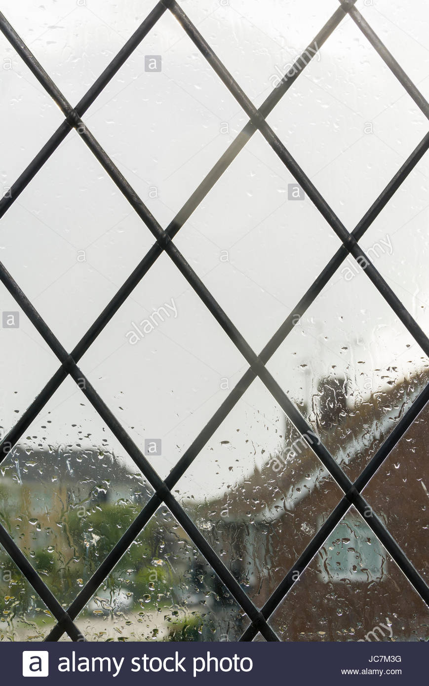 Looking outside through a window to a raining wet day. - Stock Image