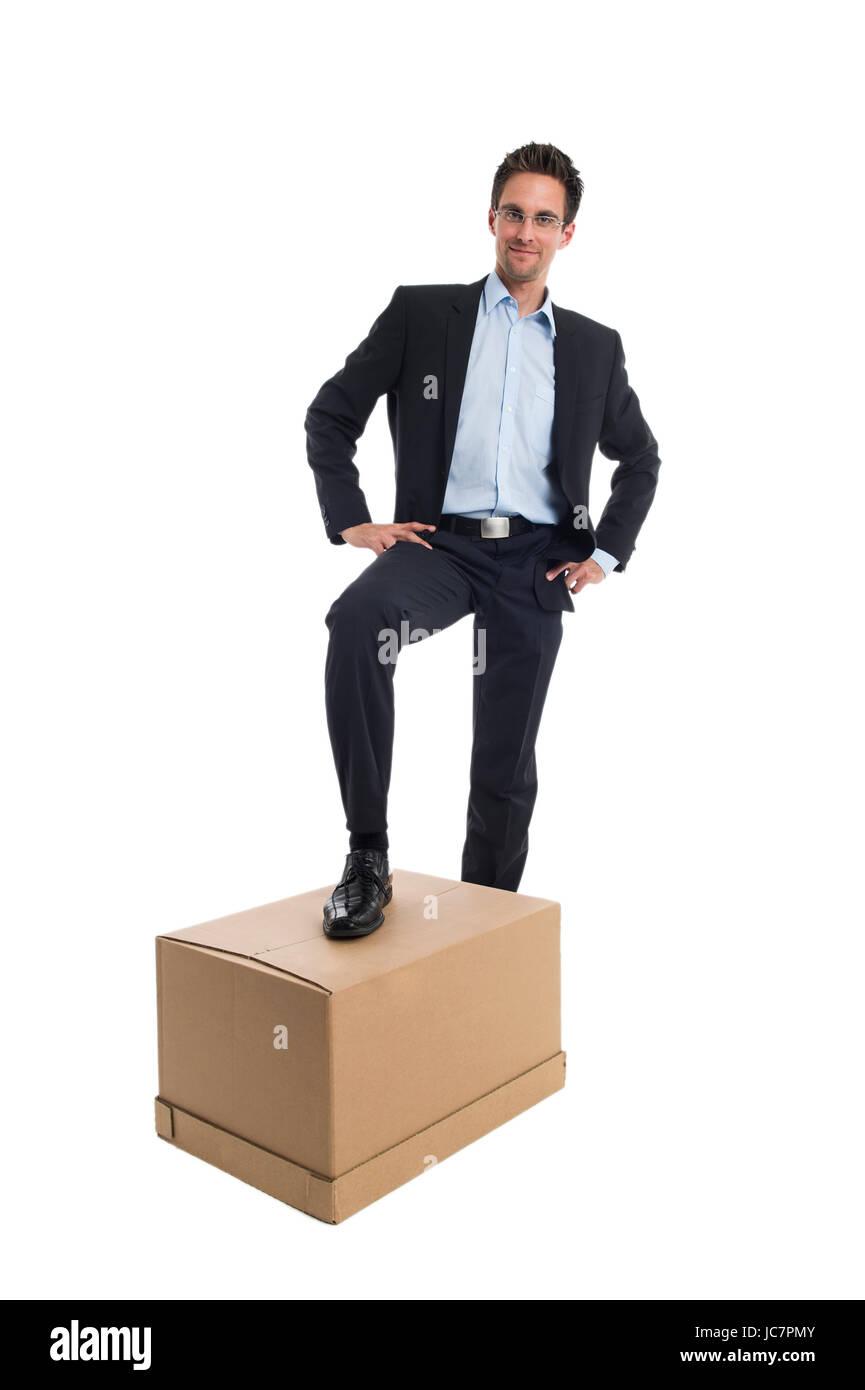 Geschäftsmann mit einer Box Stock Photo