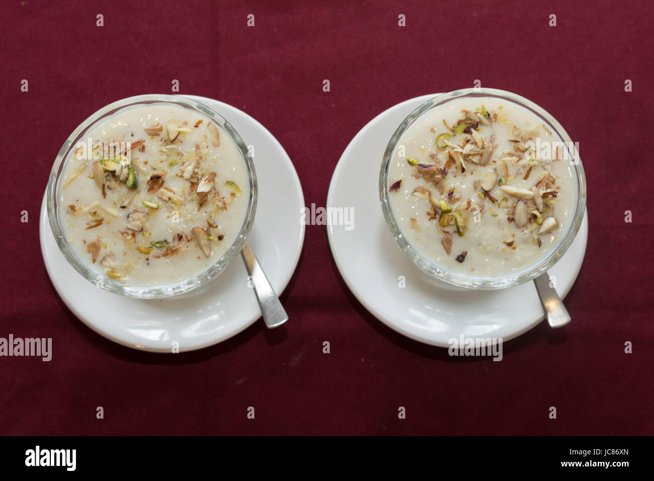 Rabri or rabdi is a sweet, condensed-milk-based dish made by boiling the milk on low heat for a long time until - Stock Image