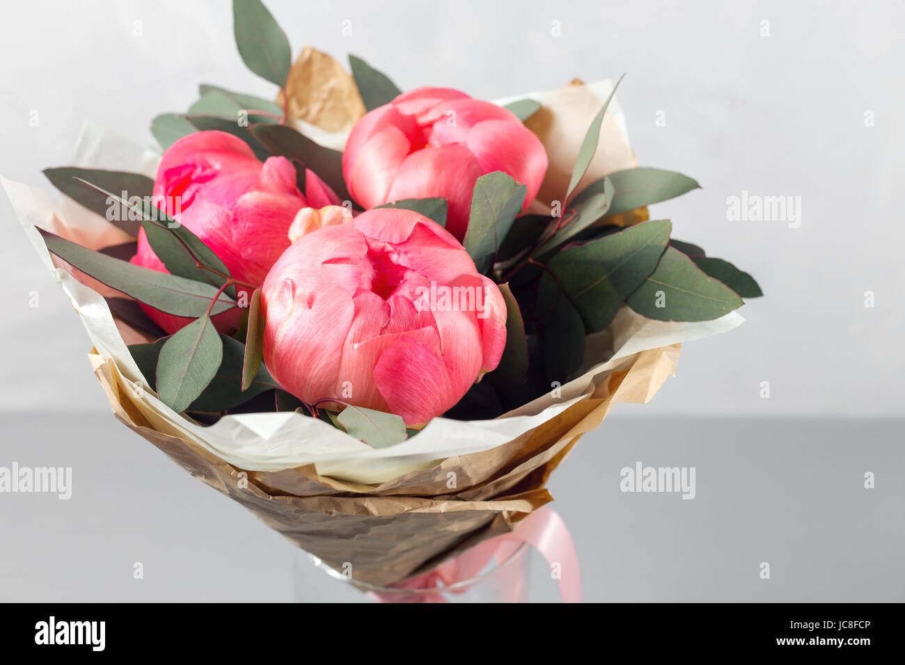 vase of peonies in the foreground. Workshop florist. Stock Photo