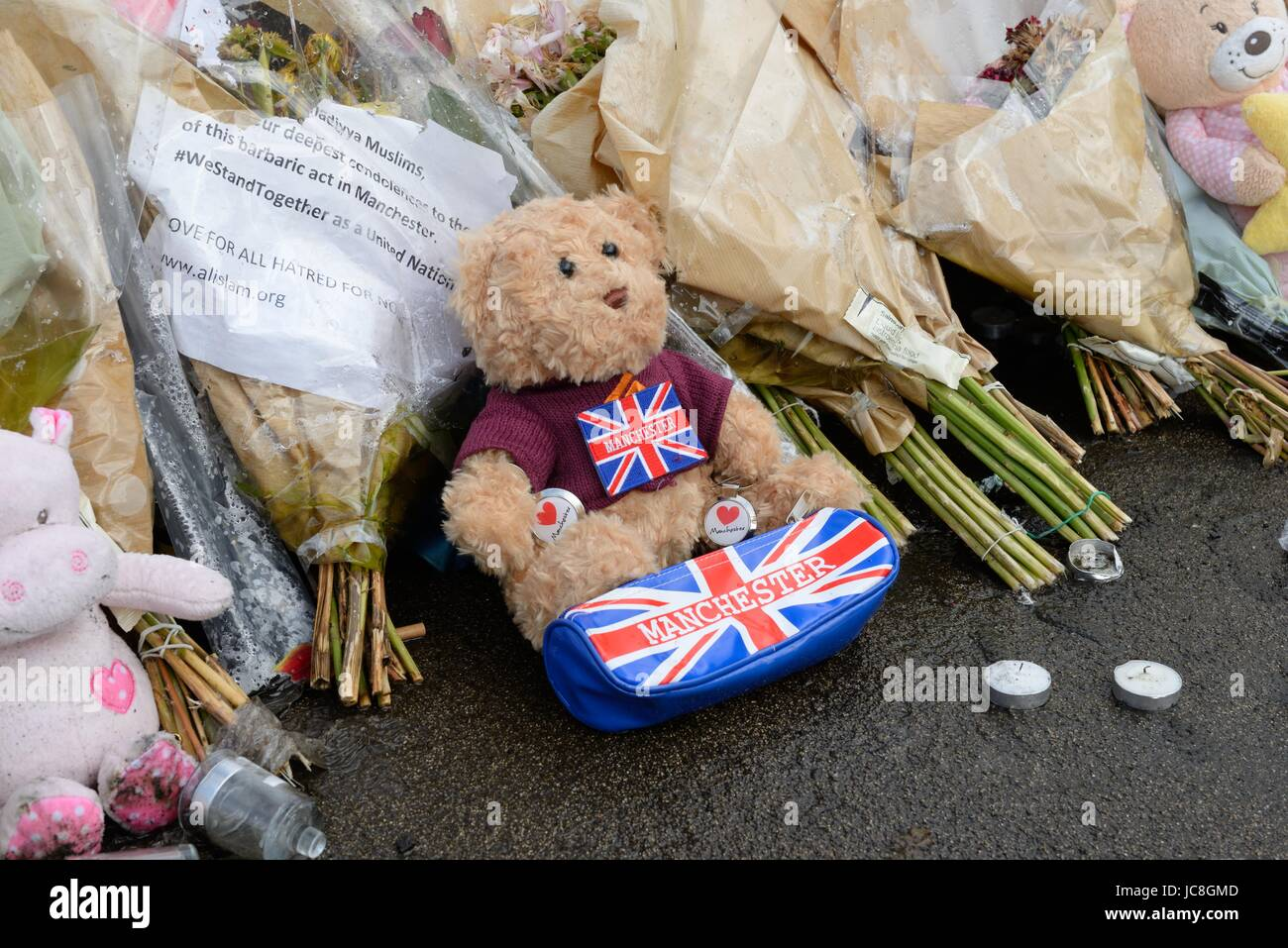 A variety of objects left at George Square, Glasgow to commemorate and honour the victims of the Manchester and - Stock Image