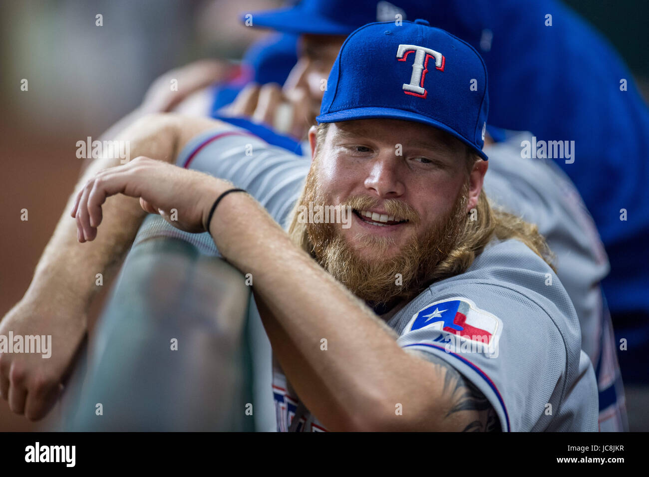Houston, TX, USA. 13th June, 2017. Texas Rangers pitcher A.J. Griffin (64) smiles in the dugout during a Major League - Stock Image