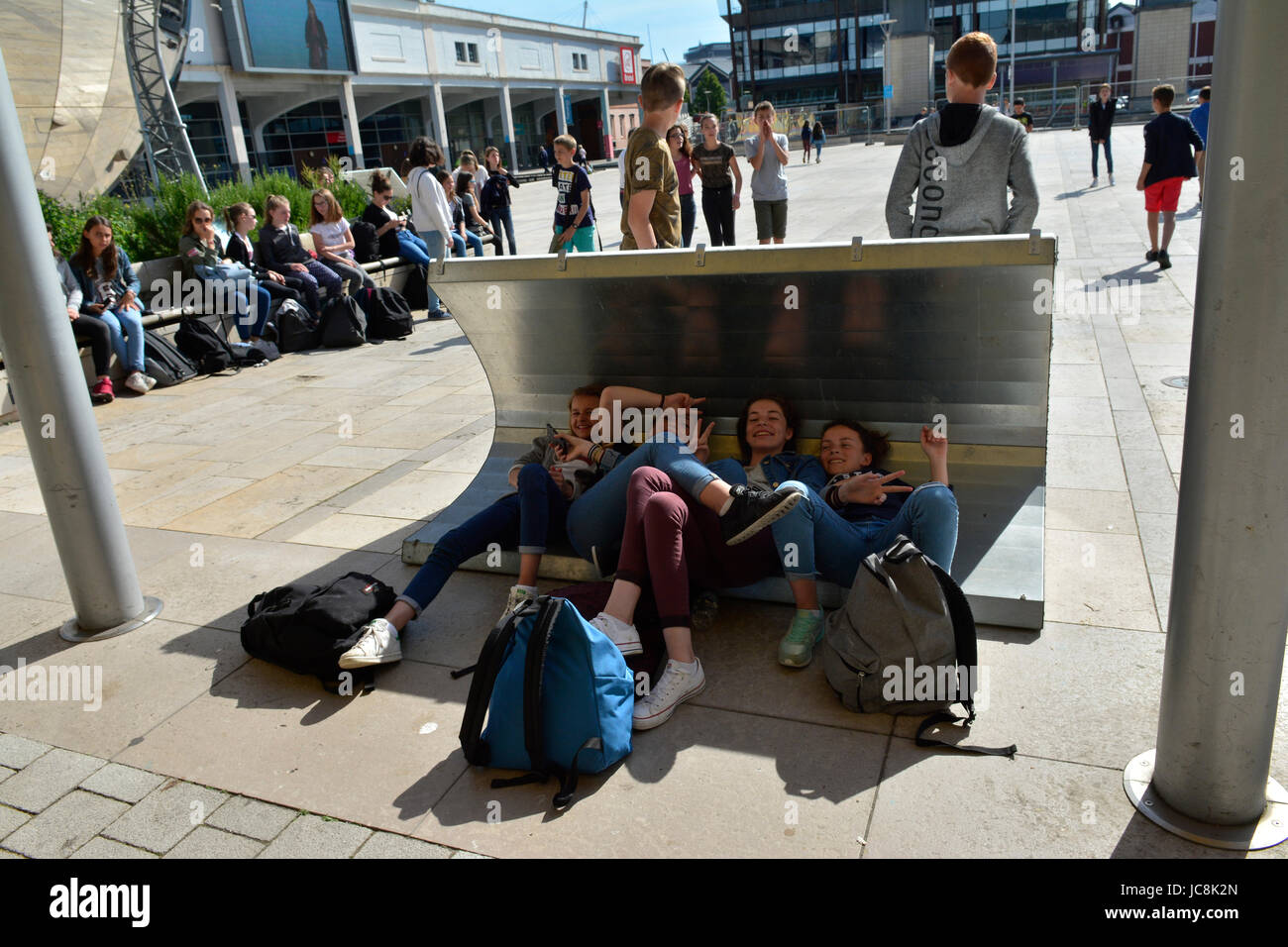 Bristol, UK. 14th June, 2017. UK weather. French Students/Schools enjoying the 1st big heat wave in Millennium Square - Stock Image
