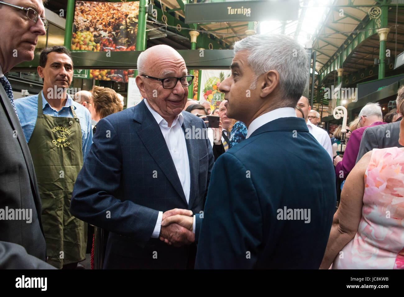 London, UK. 14th June, 2017. London Mayor Sadiq Khan speaks to Rupert Murdoch at Borough Market as it re-opens Borough - Stock Image