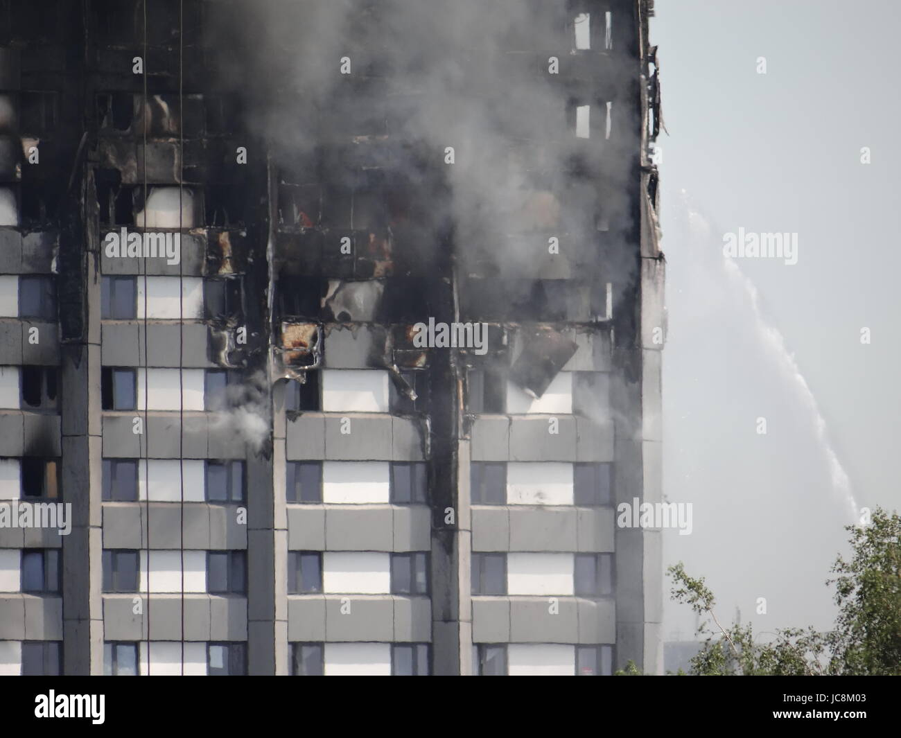 London, UK. 14th June, 2017. Fire fighters are trying to stop he fire in West London where the Grenfell Tower was - Stock Image