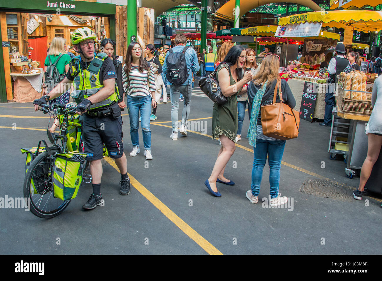 London, UK. 14th June, 2017. Authorities remain vigilant with Police and Paramedics highly visible - The market - Stock Image