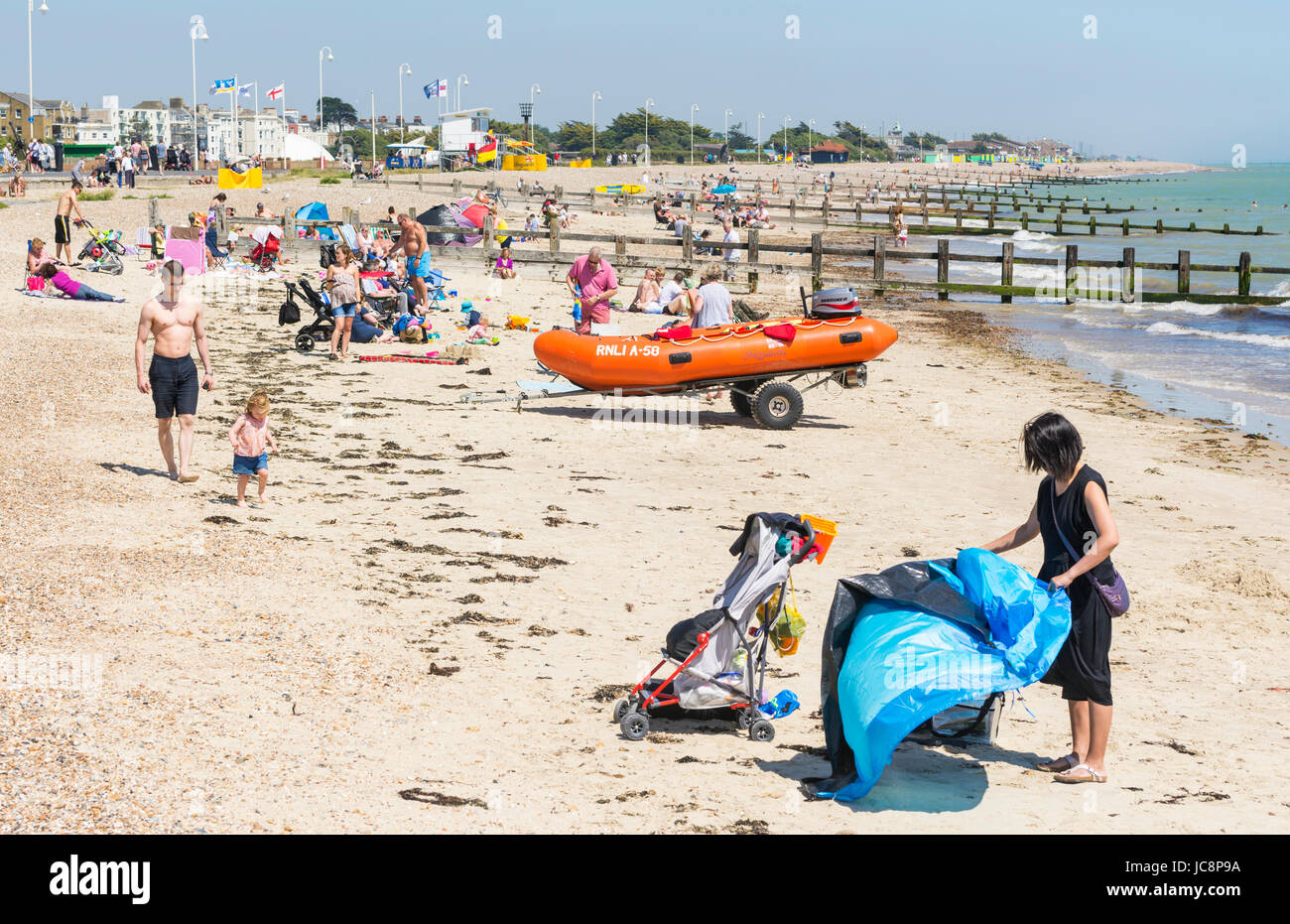 People having fun in the sun on a beach in the Summer of June 2017 in Littlehampton, West Sussex, England, UK. - Stock Image