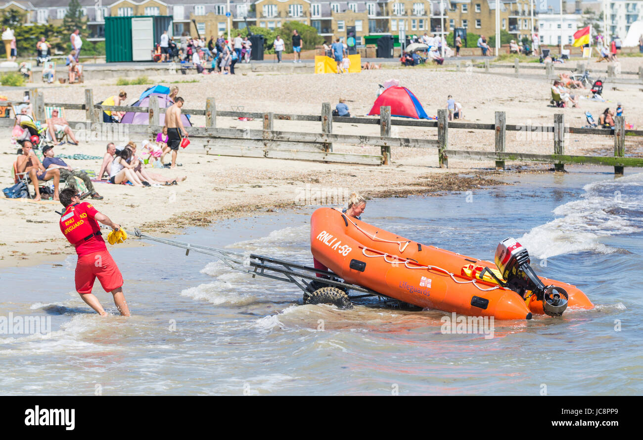 RNLI lifeguards prepare a rib to rush out to an incident on a hot Summer's day in June 2017 in Littlehampton, - Stock Image