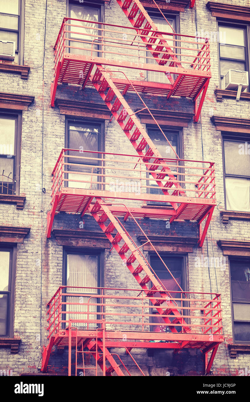 Vintage toned photo of a residential building fire escape in Manhattan, New York City, USA. - Stock Image