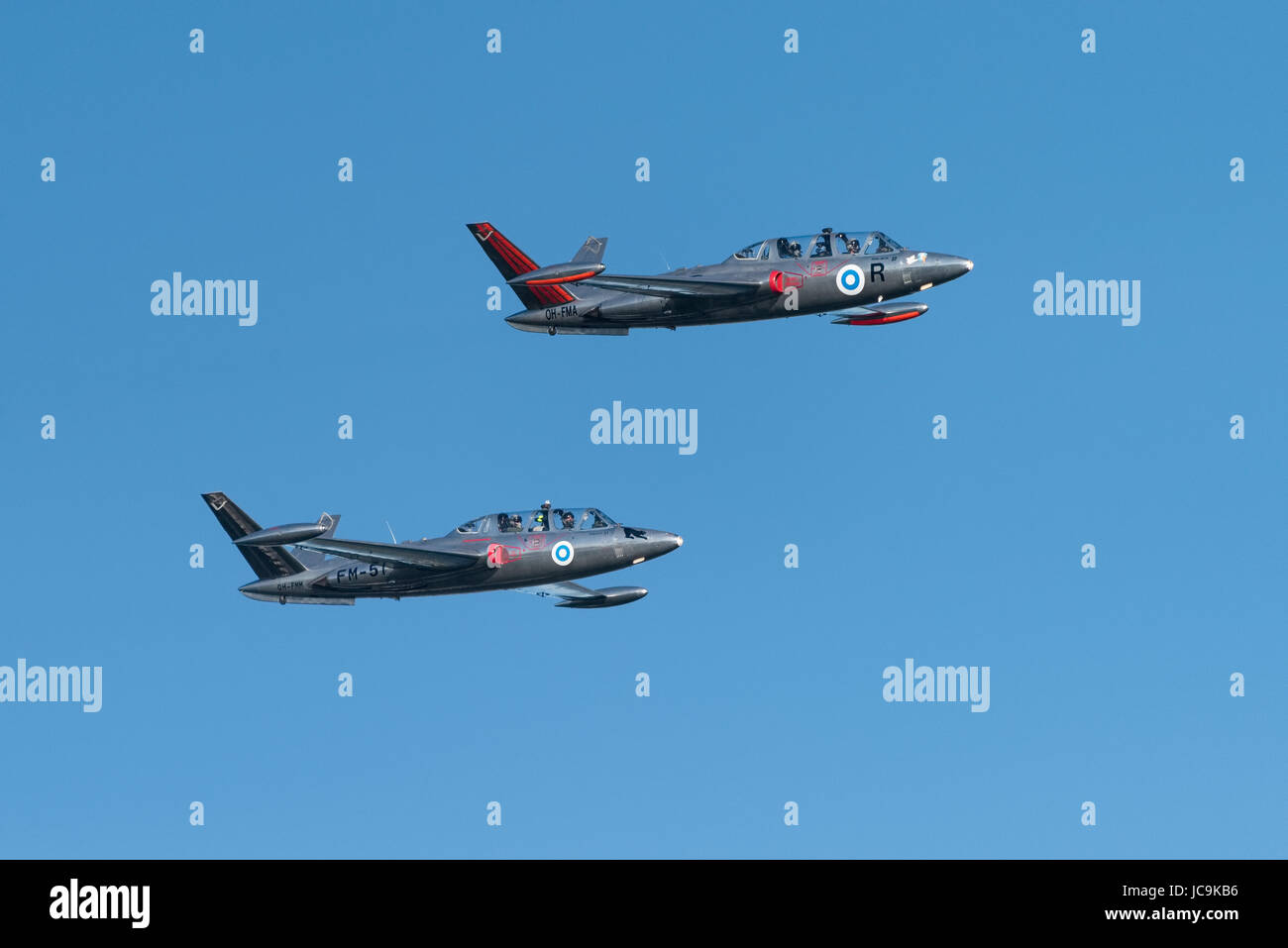 Helsinki, Finland - 9 June 2017: Two Silver Jets Aerobatic Team Fouga CM 170 Magister jets flying at the Kaivopuisto - Stock Image