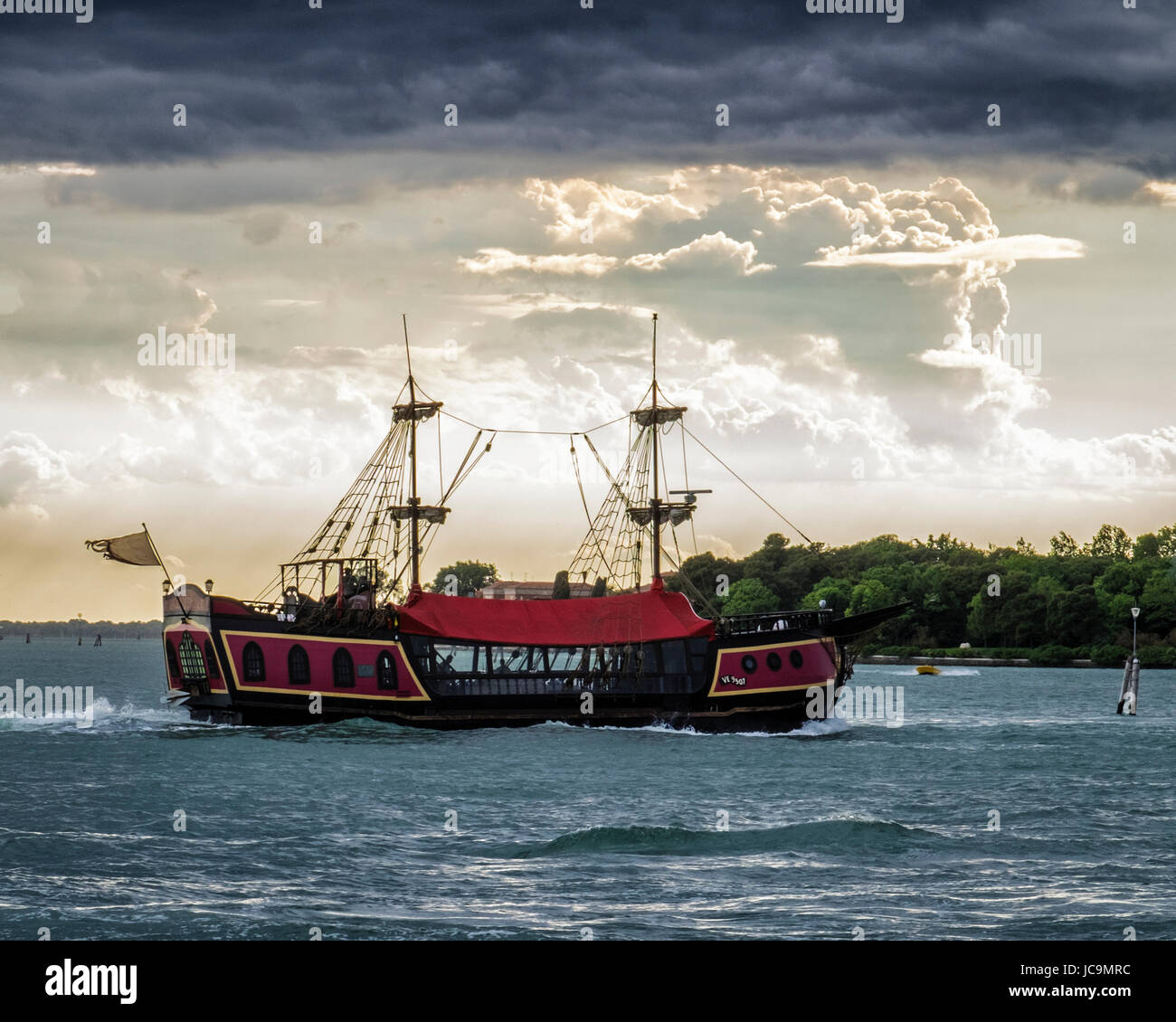 Italy,Venice,Castello.Laguno Veneto,Venetian lagoon with tail ship and black clouds of storm,Sailing ship and cloudy - Stock Image