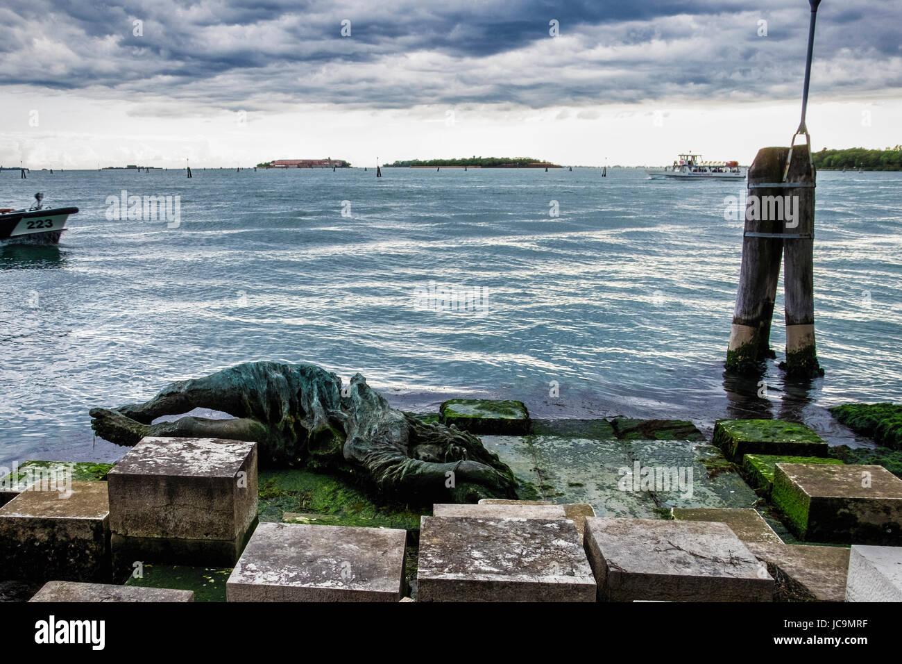 Italy Venice.War memorial,Venezia alla partigiana. Water side Bronze sculpture commemorates the women of the Italian - Stock Image