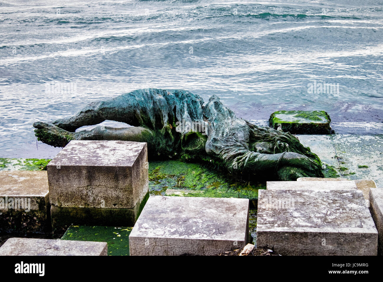 Italy Venice.War memorial,Venezia alla partigiana. Water side Bronze sculpture commemorates the women of the Italian Stock Photo